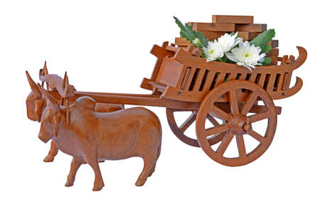 Teak wood craved cow and the carts  photo