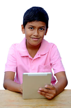 Asian boy playing with his tablet computer isolated on white  photo