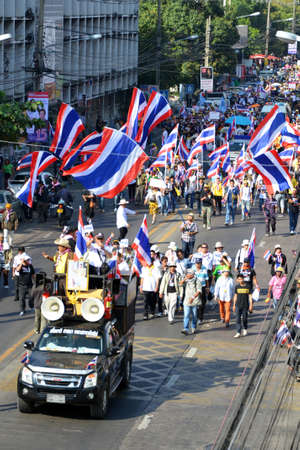 Unidentified protesters protest against Thai government corruption walking to join  Shut down Bangkok  campaign  on January 13,2014 in Bangkok,Thailand