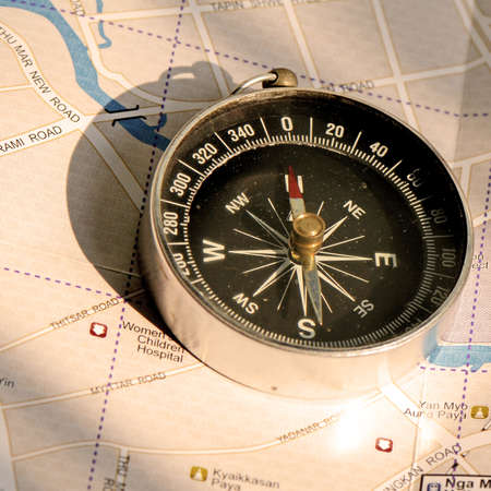 An old compass and the travelling map guide