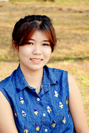 Portrait of smiling young beautiful Asian woman  Stock Photo