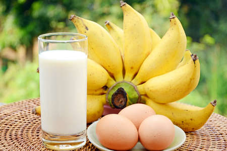A glass of fresh milk, bananas and organic fresh eggs, simple and good protein calcium and vitamin diet source