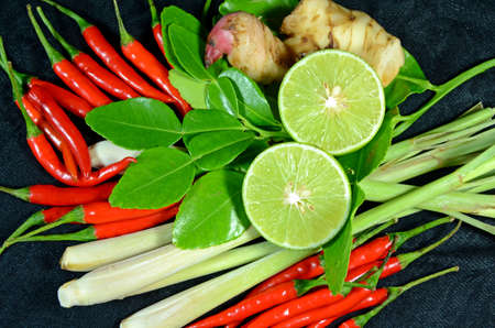 Ingredients for Thai cuisine Tom Yum include lemongrass stem, lemon juice, galanga root, chili and kaffir lime leaves photo