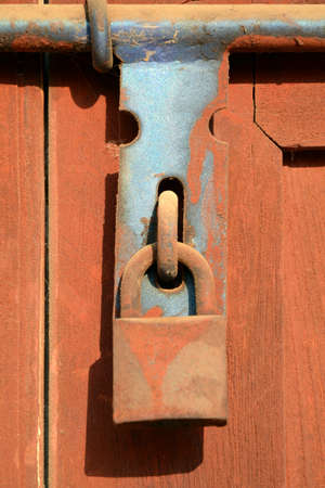 Rust lock on wooden door  The old style of door lock almost found in Asia house and building  photo