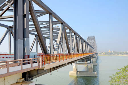 The new metal bridge over Ayeyarwady river, one of the transportation route between Sagaing city and Mandalay, Myanmar  photo