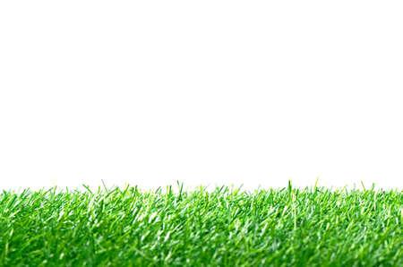 人工芝サッカー フィールドを白い背景で隔離の