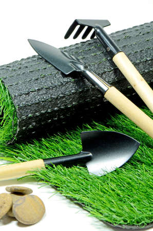 Small Gardening Tools and Artificial Turf Isolated on White Background  Stock Photo