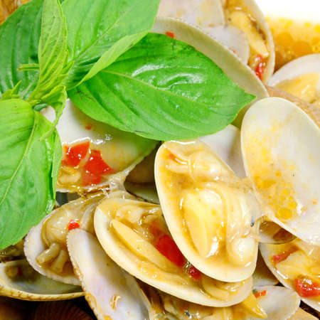STIR FRIED CLAMS WITH ROASTED CHILI PASTE AND THAI BASIL LEAVES  photo