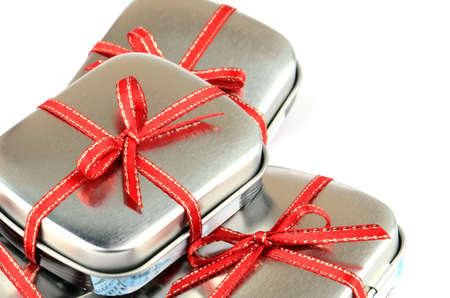 Tin Present Box with Red Ribbon. photo