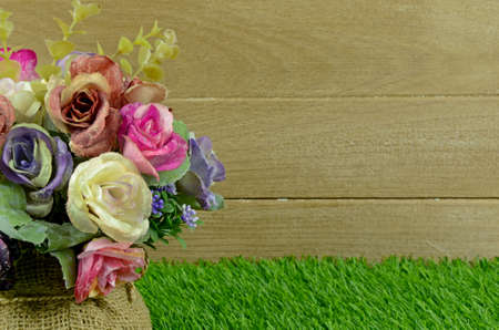 Colorful Flowers Bouquet Decorated on Old Wood and Turf Background. photo