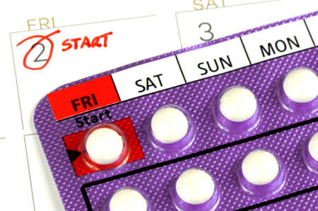 Strip of Contraceptive Pill on the Calendar with Start Taking Date Remark.