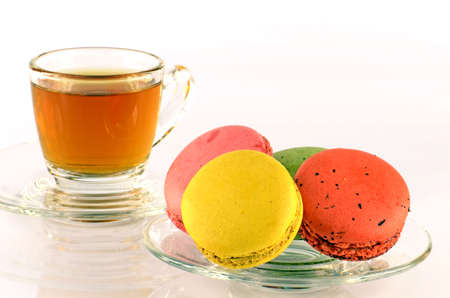 Tea Time with Sweet Macaroons on White Background.