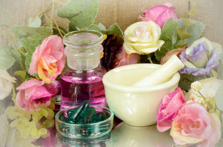 apothecary: Herbal medicine products and medicine grinder on floral background
