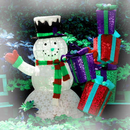Snowman and Gift Boxes. Stock Photo