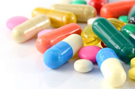 Colorful of oral medications on White Background.