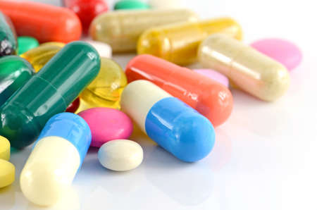 over the counter: Colorful of oral medications on White Background.
