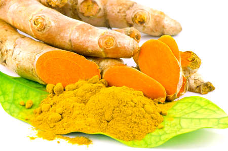 dry powder: Turmeric (Curcuma longa L.) root and turmeric powder for alternative medicine ,spa products and food ingredient. Stock Photo