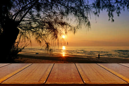 picknick: Outdoor Picnic Background with Wooden Table in Sunrise at Wanakorn Beach National Park, Prachuap Khiri Khan Province, Thailand.