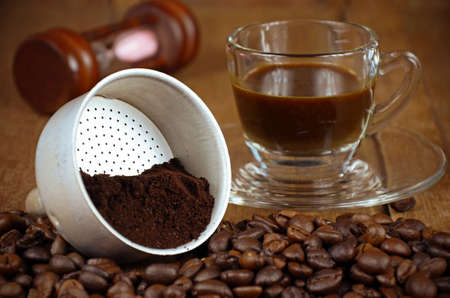 coffee filter: Presurize Coffee Filter with Roasted and Grounded Coffee Beans Makes an Espresso Shot.