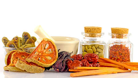 pestel: Herbal Medicine tablet and dried herbs.