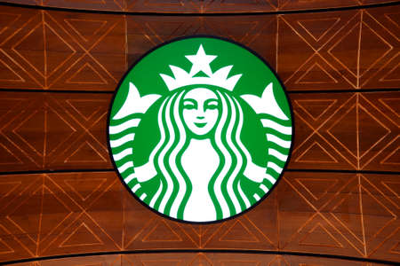 franchises: BANGKOK, THAILAND - JUNE 28, 2015: A new branch of Starbucks coffee available in Bangkok, Thailand. Starbucks is the largest coffee franchises in the world, currently.