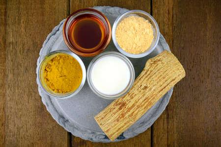 face in tree bark: Myanmar Luxuary facial mask with Tanaka(Naringi crenulata (Roxb.) Nicolson), fresh milk, turmeric powder and honey. Stock Photo