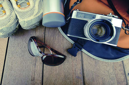footware: Travelling set with wood background in vintage look.