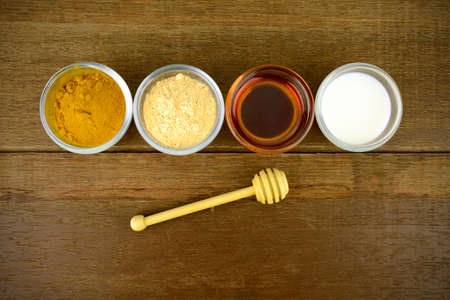 Facial mask with Tanaka(Naringi crenulata (Roxb.) Nicolson), fresh milk, turmeric powder and honey. Stock Photo