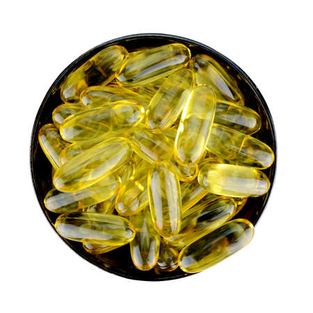 primrose oil: Soft gelatin capsule medicine isolated with clipping path. Stock Photo