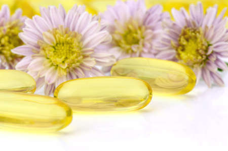 primrose oil: Oval shape of soft gelatin capsule use in pharmaceutical manufacturing for contain oily drug and nutritional supplement like vitamin A, E, fish oil, primrose oil, rice barn oil and other oily drugs. Stock Photo