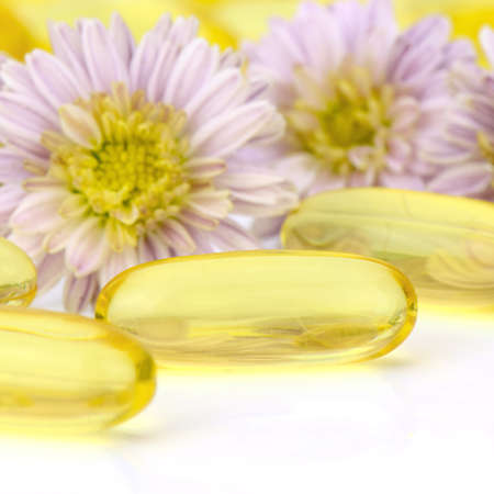 evening primrose oil: Oval shape of soft gelatin capsule use in pharmaceutical manufacturing for contain oily drug and nutritional supplement like vitamin A, E, fish oil, primrose oil, rice barn oil and other oily drugs. Stock Photo