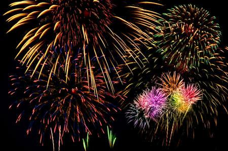 fires artificial: Colorful firework celebration on dark background.