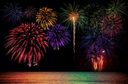 fires artificial: Colorful fireworks celebration and the city night light background. Stock Photo