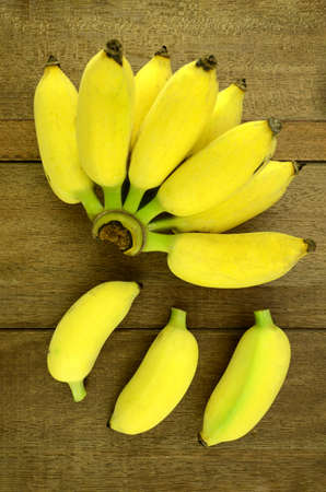 musa: Cultivated Banana (Musa sapientum Linn.) on Natural Wood Background.