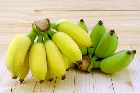 Cultivated Banana (Musa sapientum Linn.) on Natural Wood Background.