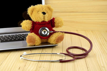 pediatric: Pediatric Desk withTeddy Bear and Stethoscope in Children Clinic Concept.