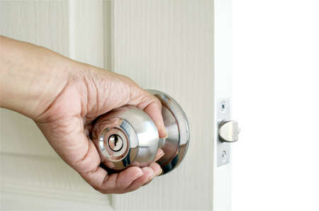doorhandle: Left hand open the door isolated on white background with clipping path.