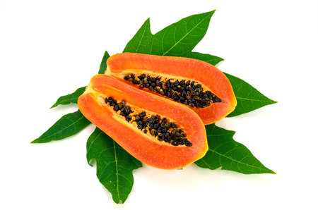 l agriculture: Ripe papaya (Carica papaya L) with leaves isolated with clipping path. Stock Photo