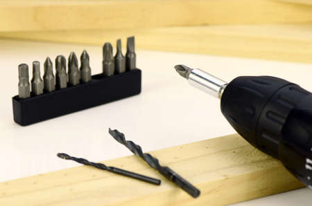 cordless: Cordless screwdrivers with various kind of screw tips. Stock Photo
