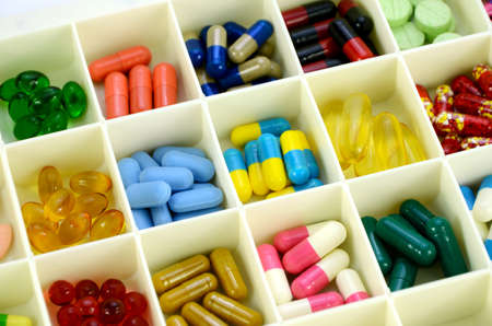 pill box: Large pill box for individual weekly pill storage. Pill Box for polypharmacy patients. Stock Photo