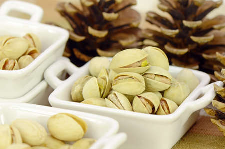 Roasted Pistachio in Closed-up in Small Ceramic Cup. Stock Photo