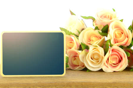 Wooden board signs on roses background with warm light tone.