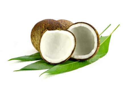 nucifera: Coconut (Cocos nucifera). Cut coconut shell with fresh organic coconut kernel redy for make coconut milk and cold press coconut oli.