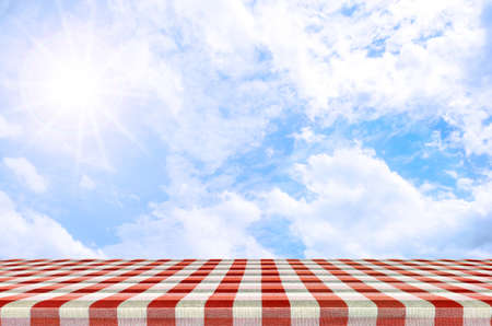 Sunny day with blue sky background. Outdoor picnic background in summer sun light.