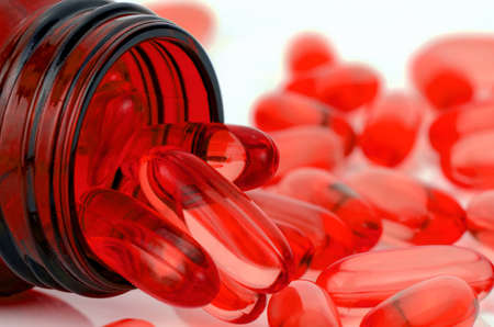 Red soft gelatin capsule use in pharmaceutical manufacturing for contain oily drug and nutritional supplement like vitamin A, E, fish oil, primrose oil, rice barn oil and other oily drugs.