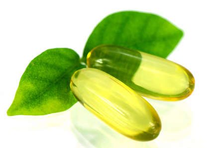 Yellow soft gelatin capsule in natural products concept.