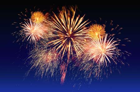 Colorful fireworks celebration and the city night light background. Stock Photo