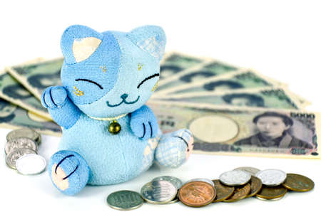 Maneki-neko, the lucky cat and Japanese money.