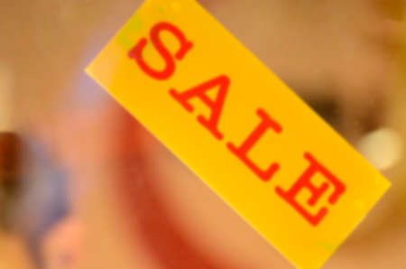 Blurred Sale banner on window displayed background. Stock Photo
