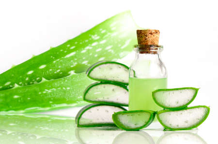 Cut Aloe Vera leaves and Aloe Vera products. Aloe Vera is very useful herbal medicine for skin care and hair care.